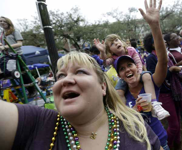 Revelers yell for beads and trinkets during the Krewe of Mid-City Mardi Gras parade in New Orleans, Sunday, Feb. 10, 2013. &#40;AP Photo&#47;Gerald Herbert&#41; <span class=meta>(AP Photo&#47; Gerald Herbert)</span>