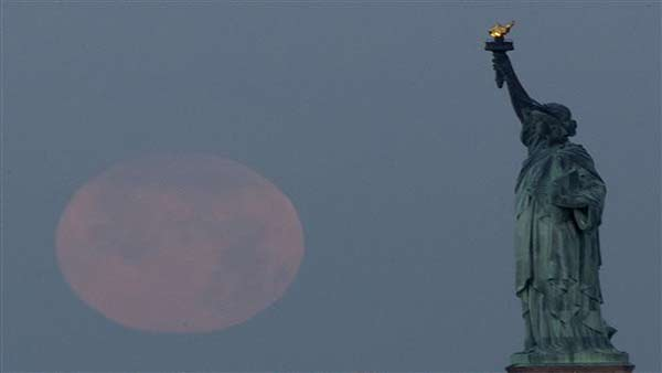 "<div class=""meta image-caption""><div class=""origin-logo origin-image ""><span></span></div><span class=""caption-text"">A supermoon sets near the Statue of Liberty, Sunday, June 23, 2013, in New York. The larger than normal moon called the ""Supermoon"" happens only once this year as the moon on its elliptical orbit is at its closest point to earth and is 13.5 percent larger than usual. (AP Photo/Julio Cortez) (AP Photo/ Julio Cortez)</span></div>"