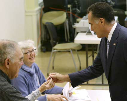 Republican presidential candidate, former Massachusetts Gov. Mitt Romney, is given an &#34;I voted&#34; sticker after he and wife Ann Romney voted in Belmont, Mass., Tuesday, Nov. 6, 2012. &#40;AP Photo&#47;Charles Dharapak&#41; <span class=meta>(AP Photo&#47; Charles Dharapak)</span>