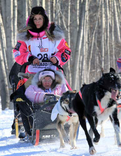 DeeDee Jonrowe drives her team during the ceremonial start of the Iditarod Trail Sled Dog Race Saturday, March 2, 2013, in Anchorage, Alaska. The competitive portion of the 1,000-mile race is scheduled to begin Sunday in Willow, Alaska. &#40;AP Photo&#47;Dan Joling&#41; <span class=meta>(AP Photo&#47; Dan Joling)</span>