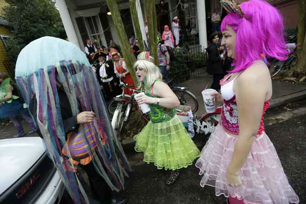 "<div class=""meta image-caption""><div class=""origin-logo origin-image ""><span></span></div><span class=""caption-text"">Revelers gather for the start of the Society of Saint Anne walking parade in the Bywater section of New Orleans during Mardi Gras day, Tuesday, Feb. 12, 2013. FEMA markings from Hurricane Katrina are still seen on the wall. (AP Photo/Gerald Herbert)</span></div>"