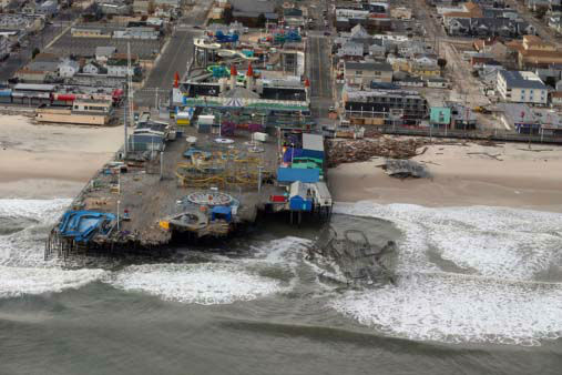 The view of storm damage over the Atlantic Coast in Seaside Heights, N.J., Wednesday, Oct. 31, 2012, from a helicopter traveling behind the helicopter carrying President Obama and New Jersey Gov. Chris Christie, as they viewed storm damage from superstorm Sandy.  <span class=meta>(AP Photo&#47;Doug Mills, Pool)</span>
