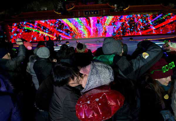 A Chinese couple kiss each other as they celebrate the new year during a count-down event at the Summer Palace in Beijing Tuesday, Jan. 1, 2013. &#40;AP Photo&#47;Andy Wong&#41; <span class=meta>(AP Photo&#47; Andy Wong)</span>