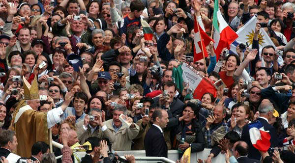 "<div class=""meta image-caption""><div class=""origin-logo origin-image ""><span></span></div><span class=""caption-text"">FILE - In this Sunday, April 24, 2005 file photo, Pope Benedict XVI greets the crowd after celebrating his installation Mass in St. Peter's Square at the Vatican. Pope Benedict XVI announced Monday, Feb. 11, 2013, he would resign Feb. 28 because he is simply too old to carry on. (AP Photo/Gregorio Borgia, File) (AP Photo/ Gregorio Borgia)</span></div>"