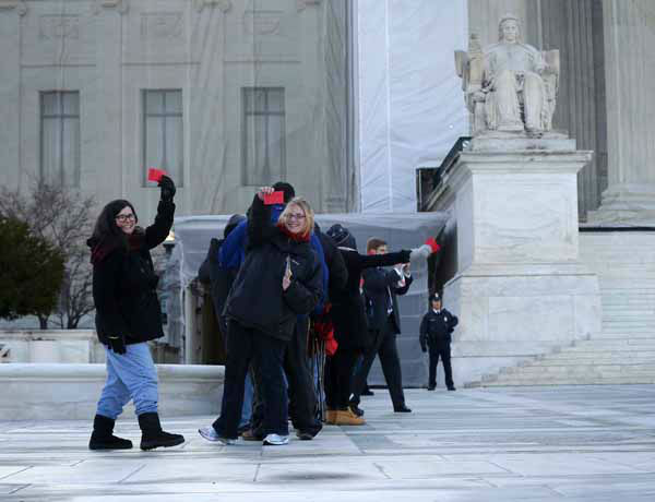 People hold up their tickets that had been issued to the general public for entrance Supreme Court in Washington, Tuesday, March 26, 2013, for the court&#39;s hearing on California?s voter approved ban on same-sex marriage. Some people waited in line _ even through light snow _ since Thursday for the coveted seats for the argument over California&#39;s Proposition 8.  &#40;AP Photo&#47;Pablo Martinez Monsivais&#41; <span class=meta>(AP Photo&#47; Pablo Martinez Monsivais)</span>