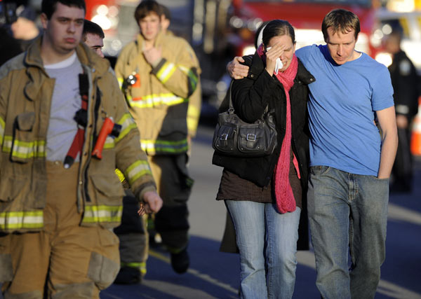 "<div class=""meta ""><span class=""caption-text "">Victims family leave a firehouse staging area following a shooting at the Sandy Hook Elementary School in Newtown, Conn., about 60 miles (96 kilometers) northeast of New York City, Friday, Dec. 14, 2012. An official with knowledge of Friday's shooting said 27 people were dead, including 18 children.  (AP Photo/Jessica Hill)</span></div>"