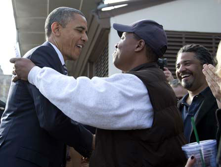 President Barack Obama visits with people outside a campaign office the morning of the 2012 election, Tuesday, Nov. 6, 2012, in Chicago. &#40;AP Photo&#47;Carolyn Kaster&#41; <span class=meta>(AP Photo&#47; Carolyn Kaster)</span>