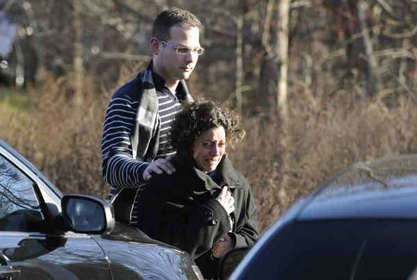 "<div class=""meta ""><span class=""caption-text "">A man and woman leave the staging area for family around near the scene of a shooting at the Sandy Hook Elementary School in Newtown, Conn., about 60 miles (96 kilometers) northeast of New York City, Friday, Dec. 14, 2012. An official with knowledge of Friday's shooting said 27 people were dead, including 18 children.  (AP Photo/Jessica Hill) (AP Photo/ Jessica Hill)</span></div>"