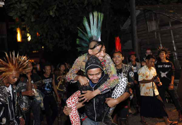 Myanmar punks dance as they hold their home made New Year cerebration in Yangon, Monday, Dec.31, 2012, in Yangon, Myanmar. &#40;AP Photo&#47;Khin Maung Win&#41; <span class=meta>(AP Photo&#47; Khin Maung Win)</span>