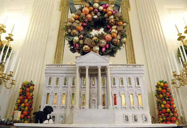 "<div class=""meta image-caption""><div class=""origin-logo origin-image ""><span></span></div><span class=""caption-text"">Bo, the Obama family pet, is replicated on the nearly 300-pound gingerbread house of the White House on display in the State Dining Room of the White House in Washington, Wednesday, Nov. 28, 2012. The theme for the White House Christmas 2012 is Joy to All. The White House gingerbread house has been a tradition since the 1960s. (AP Photo/Susan Walsh) (AP Photo/ Susan Walsh)</span></div>"