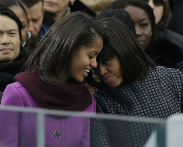 First lady Michelle Obama speaks with her daughter Sasha at the ceremonial swearing-in for President Barack Obama at the U.S. Capitol during the 57th Presidential Inauguration in Washington, Monday, Jan. 21, 2013. &#40;AP Photo&#47;Pablo Martinez Monsivais&#41; <span class=meta>(AP Photo&#47; Pablo Martinez Monsivais)</span>