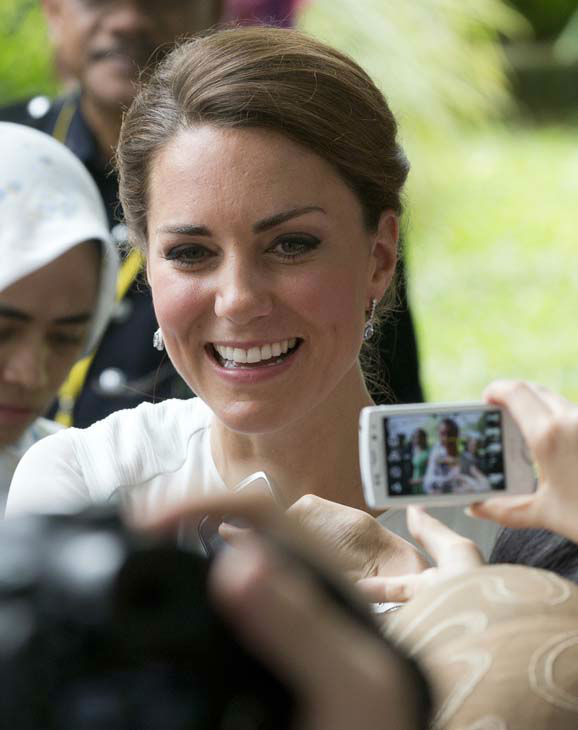 Kate, the Duchess of Cambridge shakes hands with well-wishers during a walk through a central city park in Kuala Lumpur, Malaysia, Friday, Sept. 14, 2012.  Prince William and Kate are on a nine-day tour of the Far East and South Pacific in celebration of Queen Elizabeth II&#39;s Diamond Jubilee. &#40;AP Photo&#47;Mark Baker&#41; <span class=meta>(AP Photo&#47; Mark Baker)</span>