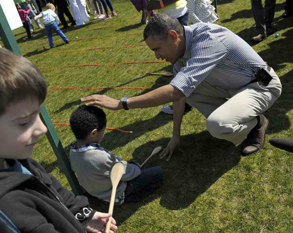 President Barack Obama comforts five-year-old Donovan Frazier of Scranton, Pa., after he participated in the annual Easter Egg Roll on the South Lawn of the White House in Washington, Monday, April 1, 2013. &#40;AP Photo&#47;Susan Walsh&#41; <span class=meta>(AP Photo&#47; Susan Walsh)</span>