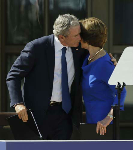 Former president George W. Bush hugs his wife Laura Bush during the dedication of the George W. Bush Presidential Center Thursday, April 25, 2013, in Dallas. &#40;AP Photo&#47;David J. Phillip&#41; <span class=meta>(AP Photo&#47; David J. Phillip)</span>