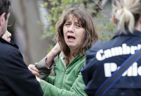 "<div class=""meta image-caption""><div class=""origin-logo origin-image ""><span></span></div><span class=""caption-text"">An unidentified resident of Norfolk Street in Cambridge, Mass., talks with police, Friday, April 19, 2013.  Two suspects in the Boston Marathon bombing killed an MIT police officer, injured a transit officer in a firefight and threw explosive devices at police during a getaway attempt in a long night of violence that left one of them dead and another still at large Friday, authorities said as the manhunt intensified for a young man described as a dangerous terrorist.  (AP Photo/Michael Dwyer) (AP Photo/ Michael Dwyer)</span></div>"