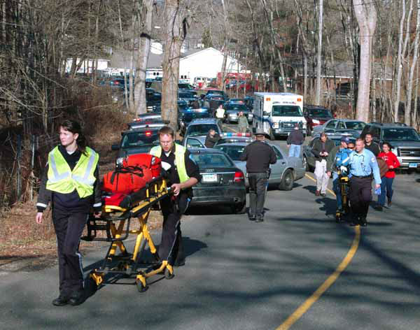 In this photo provided by the Newtown Bee, paramedics push stretchers toward Sandy Hook Elementary School in Newtown, Conn., where authorities say a gunman opened fire, killing 26 people, including 20 children, Friday, Dec. 14, 2012. &#40;AP Photo&#47;Newtown Bee, Shannon Hicks&#41; MANDATORY CREDIT: NEWTOWN BEE, SHANNON HICKS <span class=meta>(AP Photo&#47; Shannon Hicks)</span>