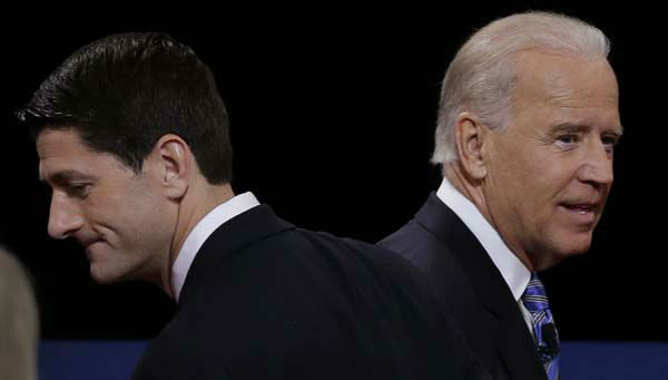 "<div class=""meta ""><span class=""caption-text "">Republican vice presidential nominee Rep. Paul Ryan of Wisconsin and Vice President Joe Biden pass each other after the vice presidential debate at Centre College, Thursday, Oct. 11, 2012, in Danville, Ky. (AP Photo/Charlie Neibergall) (AP Photo/ Charlie Neibergall)</span></div>"