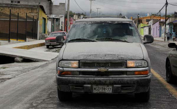 Volcanic ash coats the streets and a vehicle in San Pedro Nexapa, Mexico, Saturday, July 6, 2013. Just east of Mexico City, the Popocatepetl volcano has spit out a cloud of ash and vapor 2 miles &#40;3 kilometers&#41; high over several days of eruptions. Mexico&#39;s National Center for Disaster Prevention raised the volcano alert from Stage 2 Yellow to Stage 3 Yellow, the final step before a Red alert, when possible evacuations could be ordered. &#40;AP Photo&#47;Arturo Andrade&#41; <span class=meta>(AP Photo&#47; Arturo Andrade)</span>