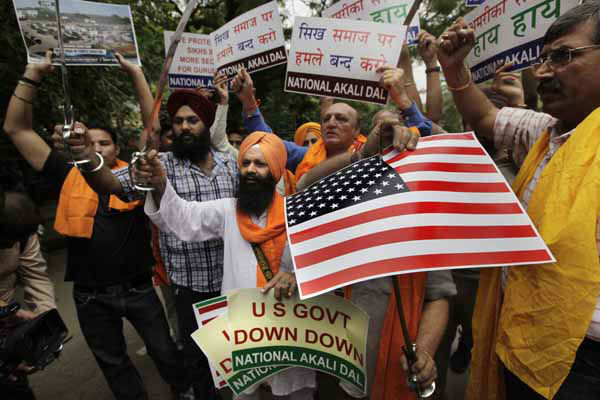 Indian Sikhs hold swords and shout slogans during a protest against the yesterday killing of 6 people at the sikh temple in US, in New Delhi, India , Monday, Aug. 6, 2012. Indian Prime Minister Manmohan Singh said Monday that he was shocked and saddened by the shooting attack that killed six people at a Sikh house of worship in the U.S. state of Wisconsin. &#40;AP Photo&#47; Manish Swarup&#41; <span class=meta>(AP Photo&#47; Manish Swarup)</span>