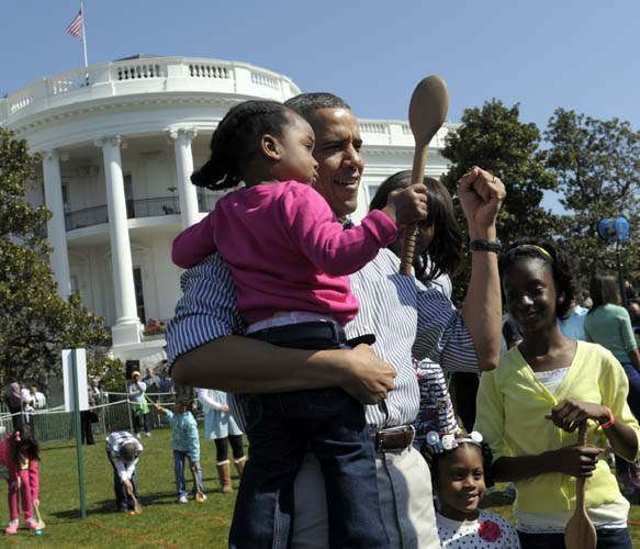 President Barack Obama hold a child after participated in the annual Easter Egg Roll on the South Lawn of the White House in Washington, Monday, April 1, 2013. &#40;AP Photo&#47;Susan Walsh&#41; <span class=meta>(AP Photo&#47; Susan Walsh)</span>