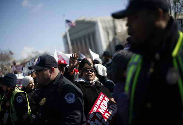 "<div class=""meta ""><span class=""caption-text "">Demonstrators march outside the Supreme Court in Washington, Tuesday, March 26, 2013, as the court heard arguments on California's voter approved ban on same-sex marriage. The Supreme Court waded into the fight over same-sex marriage Tuesday, at a time when public opinion is shifting rapidly in favor of permitting gay and lesbian couples to wed, but 40 states don't allow it.  (AP Photo/Pablo Martinez Monsivais) (AP Photo/ Pablo Martinez Monsivais)</span></div>"