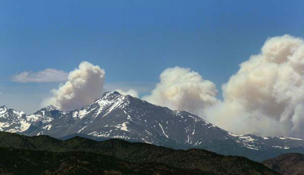 "<div class=""meta ""><span class=""caption-text "">Plumes of smoke from the Big Meadows Fire in Rocky Mountain National Park rise above Longs Peak, as seen from just east of Boulder, Colo., Tuesday June 11, 2013. A National Park crew assessed the fire that has been confirmed on the north end of Big Meadows on the west side of the park. (AP Photo/Brennan Linsley) (AP Photo/ Brennan Linsley)</span></div>"
