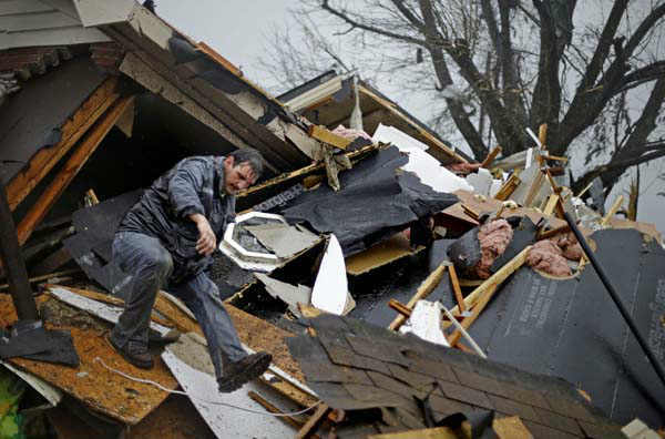 Nathan Varnes, of Cartersville, Ga., helps search a destroyed home for a dog after a tornado struck, Wednesday, Jan. 30, 2013, in Adairsville, Ga. A fierce storm system that roared across Georgia has left at least one person dead after it demolished buildings and flipped vehicles on Interstate 75 northwest of Atlanta. &#40;AP Photo&#47;David Goldman&#41; <span class=meta>(AP Photo&#47; David Goldman)</span>