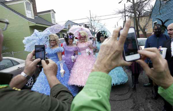Revelers gather and are photographed before the start of the Society of Saint Anne walking parade in the Bywater section of New Orleans during Mardi Gras day, Tuesday, Feb. 12, 2013. Overcast skies and the threat of rain couldn&#39;t dampen the revelry of Mardi Gras as parades took to the streets, showering costumed merrymakers with trinkets of all kinds.  &#40;AP Photo&#47;Gerald Herbert&#41; <span class=meta>(AP Photo&#47; Gerald Herbert)</span>