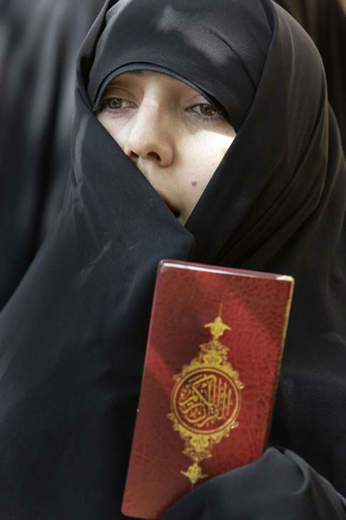An Iranian woman chants slogans as she holds a copy of the Quran, Muslims&#39; holy book, in front of the French Embassy in Tehran, Iran, Thursday, Sept. 20, 2012, during a protest the publication of caricatures of Islam&#39;s Prophet Muhammad by a French satirical weekly. The vast majority of Muslims have not taken to the streets over a film mocking the Prophet Muhammad, and behind the visible public anger a more measured debate is taking place over how much free speech is acceptable in the Muslim world. While many do yearn for more openness, few if any will go as far as accepting the right to blaspheme as the ultimate test of freedom of speech. &#40;AP Photo&#47;Vahid Salemi&#41; <span class=meta>(AP Photo&#47; Vahid Salemi)</span>