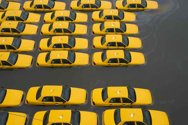 A parking lot full of yellow cabs is flooded as a result of superstorm Sandy on Tuesday, Oct. 30, 2012 in Hoboken, NJ. &#40;AP Photo&#47;Charles Sykes&#41; <span class=meta>(AP Photo&#47; Charles Sykes)</span>
