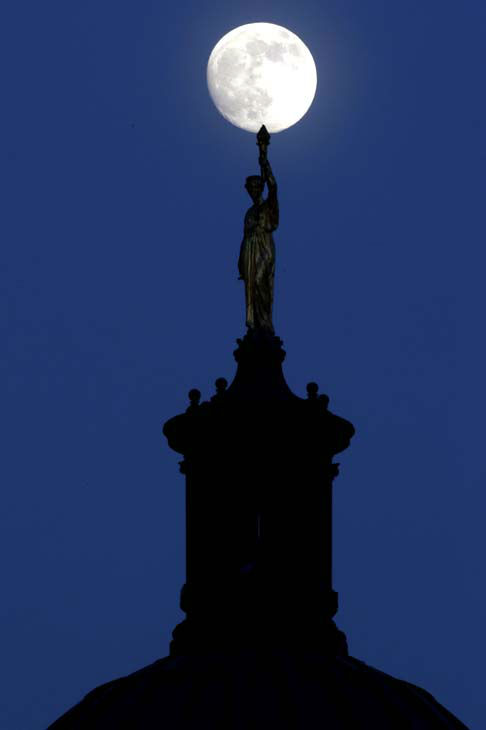 "<div class=""meta image-caption""><div class=""origin-logo origin-image ""><span></span></div><span class=""caption-text"">The moon in its waxing gibbous stage shines over a statue entitled ""Enlightenment Giving Power"" by John Gelert, which sits at the top of the dome of the Bergen County Courthouse in Hackensack, N.J., Friday, June 21, 2013. The moon, which will reach its full stage on Sunday, is expected to be 13.5 percent closer to earth during a phenomenon known as supermoon. (AP Photo/Julio Cortez) (AP Photo/ Julio Cortez)</span></div>"