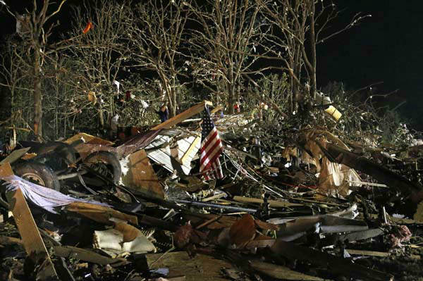 "<div class=""meta image-caption""><div class=""origin-logo origin-image ""><span></span></div><span class=""caption-text"">A flag flies in the debris of a mobile home after a tornado struck a mobile home park near Dale, Okla., Sunday, May 19, 2013. (AP Photo Sue Ogrocki) (AP Photo/ Sue Ogrocki)</span></div>"
