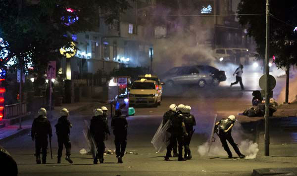 "<div class=""meta ""><span class=""caption-text "">Turkish riot police kick a tear gas canister during clashes with protesters in Ankara, Turkey, Tuesday, June 11, 2013. Turkey's Prime Minister Recep Tayyip Erdogan will meet with a group of protesters occupying Istanbul's central Taksim Square this week, Deputy Prime minister Bulent Arinc said Monday, as the government sought a way out of the impasse that has led to hundreds of protests in dozens of cities. (AP Photo/Vadim Ghirda) (AP Photo/ Vadim Ghirda)</span></div>"