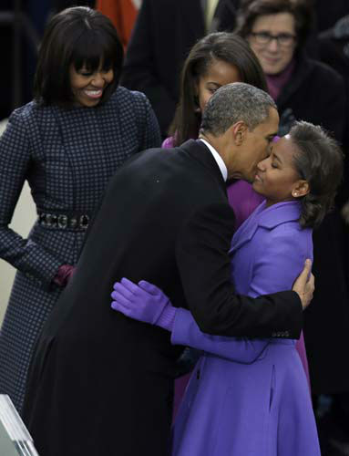 President Barack Obama kisses his daughter Sasha after being sworn-in at the ceremonial swearing-in at the U.S. Capitol during the 57th Presidential Inauguration in Washington, Monday, Jan. 21, 2013. &#40;AP Photo&#47;Evan Vucci&#41; <span class=meta>(AP Photo&#47; Evan Vucci)</span>