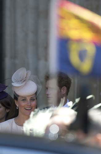 Kate, Duchess of Cambridge, looks towards the Queen&#39;s car and the Royal standard flying from its roof, with her brother-in-law, Prince Harry, in the background, following a service to celebrate the 60th anniversary of the coronation of Britain&#39;s Queen Elizabeth II at Westminster Abbey, London, Tuesday, June 4, 2013. &#40;AP Photo&#47;Alastair Grant&#41; <span class=meta>(AP Photo&#47; Alastair Grant)</span>