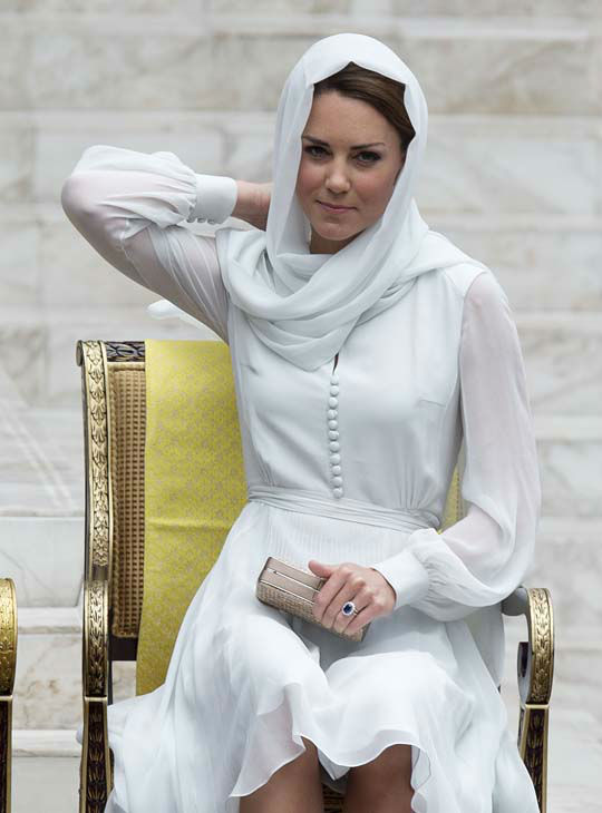 Kate, the Duchess of Cambridge prepares to visit a mosque in Kuala Lumpur, Malaysia, Friday, Sept. 14, 2012. Prince William and Kate are on a nine-day tour of the Far East and South Pacific in celebration of Queen Elizabeth II&#39;s Diamond Jubilee. &#40;AP Photo&#47;Mark Baker&#41; <span class=meta>(AP Photo&#47; Mark Baker)</span>