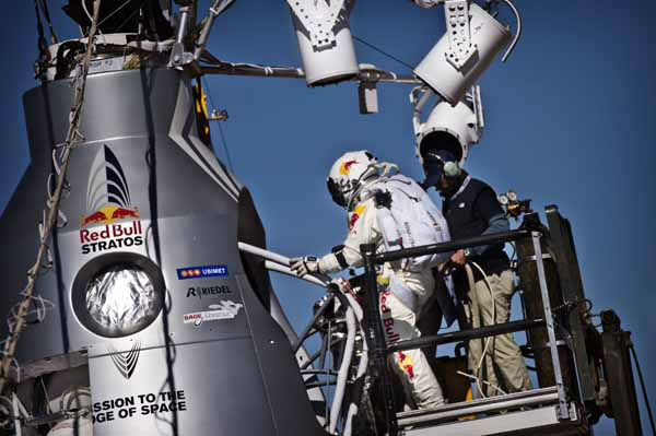 In this photo provided by Red Bull Stratos, pilot Felix Baumgartner of Austria steps into his capsule before his mission was aborted due to high winds during the final manned flight of Red Bull Stratos in Roswell, N.M., Tuesday, Oct. 9, 2012.?&#40;AP Photo&#47;Red Bull Stratos, Balazs Gardi&#41; <span class=meta>(AP Photo&#47; Balazs Gardi)</span>