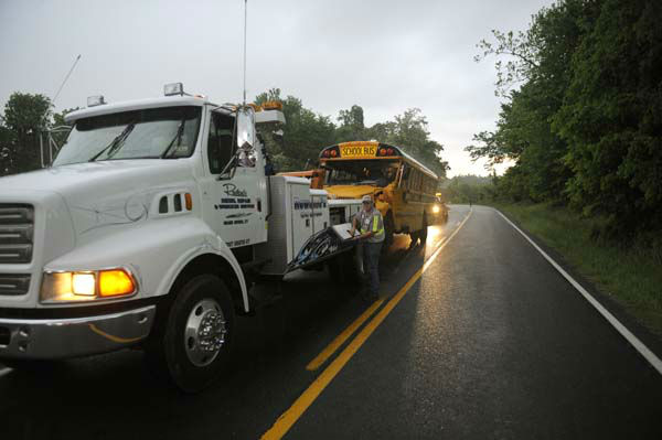 "<div class=""meta ""><span class=""caption-text "">A Union County school bus involved in wreck on U.S. 60 at Silver Mine Road near Smithland, Ky., is prepared for towing Friday, May 10, 2013. The bus was carrying the Union County High School girls' softball team and had 28 people aboard when it overturned. 25 of those on board were taken to local hospitals with non-life threatening injuries. State Police Trooper Richie Wright said one patient was airlifted from the scene, but it was not due to serious injuries. (AP Photo/Stephen Lance Dennee) (AP Photo/ Stephen Lance Dennee)</span></div>"