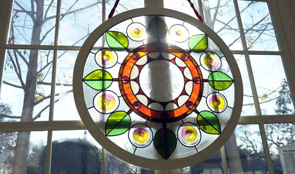 "<div class=""meta ""><span class=""caption-text "">A stained glass ""wreath: hangs in the East wing of the White House in Washington, Wednesday, Nov. 28, 2012, during a preview of the decorations. The theme for the White House Christmas 2012 is Joy to All. (AP Photo/Susan Walsh) (AP Photo/ Susan Walsh)</span></div>"
