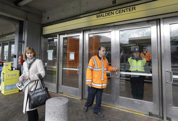 MBTA transit police turn away a commuter at Malden Center station in Malden, Mass. Friday, April 18, 2013 as area MBTA commuter trains are suspended. Two suspects in the Boston Marathon bombing killed an MIT police officer, injured a transit officer in a firefight and threw explosive devices at police during a getaway attempt in a long night of violence that left one of them dead and another still at large Friday, authorities said as the manhunt intensified for a young man described as a dangerous terrorist. &#40;AP Photo&#47;Elise Amendola&#41; <span class=meta>(AP Photo&#47; Elise Amendola)</span>