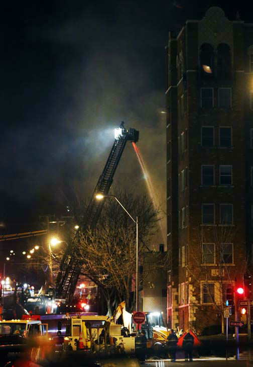 Firefighters douse a burning building at the scene of a gas explosion and massive fire Tuesday night, Feb. 19, 2013 at the Country Club Plaza in Kansas City, Mo. A car crashed into a gas main in the upscale Kansas City shopping district, sparking a massive blaze that engulfed an entire block and caused multiple injuries, police said. &#40;AP Photo&#47;Orlin Wagner&#41; <span class=meta>(AP Photo&#47; Orlin Wagner)</span>