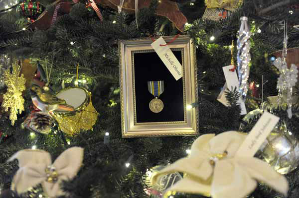 A tree honoring First ladies is on display in the Grand Foyer of the White House in White House in Washington, Wednesday, Nov. 28, 2012, during a preview of the holiday decorations. The theme for the White House Christmas 2012 is Joy to All. &#40;AP Photo&#47;Susan Walsh&#41; <span class=meta>(Photo&#47;Susan Walsh)</span>