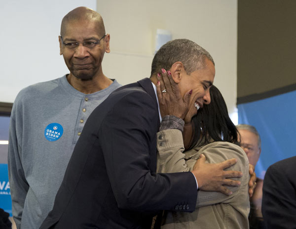 "<div class=""meta ""><span class=""caption-text "">President Barack Obama is embraced by a volunteer as he visits a campaign office the morning of the 2012 election, Tuesday, Nov. 6, 2012, in Chicago. (AP Photo/Carolyn Kaster)</span></div>"