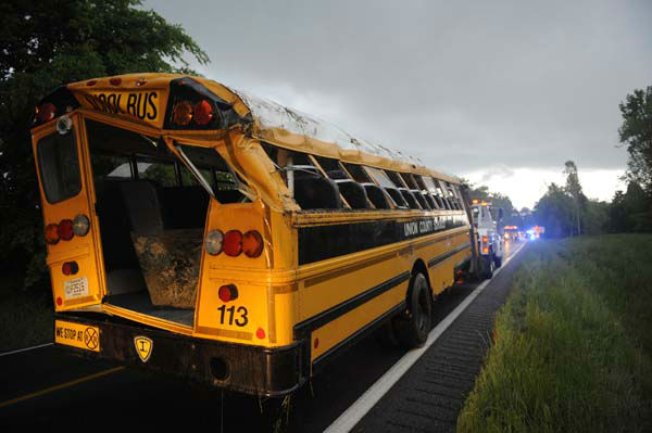 A Union County school bus involved in wreck on U.S. 60 at Silver Mine Road near Smithland, Ky., is prepared for towing Friday, May 10, 2013. The bus was carrying the Union County High School girls&#39; softball team and had 28 people aboard when it overturned. 25 of those on board were taken to local hospitals with non-life threatening injuries. State Police Trooper Richie Wright said one patient was airlifted from the scene, but it was not due to serious injuries. &#40;AP Photo&#47;Stephen Lance Dennee&#41; <span class=meta>(AP Photo&#47; Stephen Lance Dennee)</span>