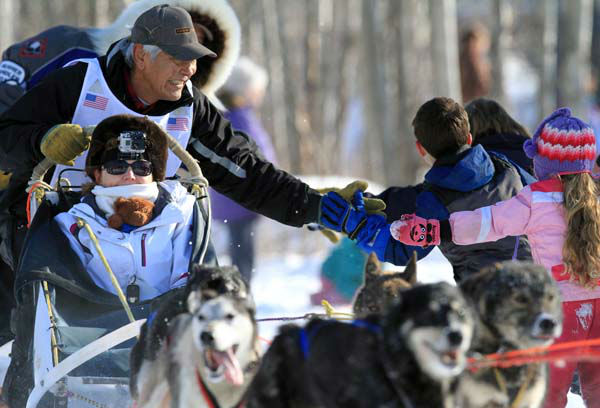 Mike Williams Sr. greets fans during the ceremonial start of the Iditarod Trail Sled Dog Race on Saturday, March 2, 2013, in Anchorage, Alaska. The competitive portion of the 1,000-mile race is scheduled to begin Sunday in Willow, Alaska. &#40;AP Photo&#47;Dan Joling&#41; <span class=meta>(AP Photo&#47; Dan Joling)</span>