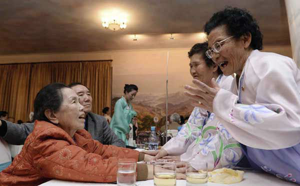 "<div class=""meta image-caption""><div class=""origin-logo origin-image ""><span></span></div><span class=""caption-text"">South Korean Lee Oh-hwan, left, 85, meets wit her North Korean family sisters during the Separated Family Reunion Meeting at Diamond Mountain resort in North Korea, Thursday, Feb. 20, 2014. Elderly North and South Koreans separated for six decades are tearfully reuniting, grateful to embrace children, brothers, sisters and spouses they had thought they might never see again. (AP Photo/Korea Pool, Kim Ju-sung)  KOREA OUT (Photo/Kim Ju-sung)</span></div>"