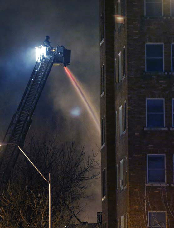 "<div class=""meta ""><span class=""caption-text "">Firefighters douse a burning building at the scene of a gas explosion and massive fire Tuesday night, Feb. 19, 2013 at the Country Club Plaza in Kansas City, Mo. A car crashed into a gas main in the upscale Kansas City shopping district, sparking a massive blaze that engulfed an entire block and caused multiple injuries, police said. (AP Photo/Orlin Wagner) (AP Photo/ Orlin Wagner)</span></div>"