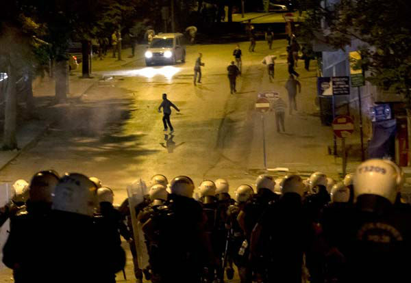"<div class=""meta image-caption""><div class=""origin-logo origin-image ""><span></span></div><span class=""caption-text"">Turkish riot police charge toward protesters during clashes in Ankara, Turkey, Tuesday, June 11, 2013. Turkey's Prime Minister Recep Tayyip Erdogan will meet with a group of protesters occupying Istanbul's central Taksim Square this week, Deputy Prime minister Bulent Arinc said Monday, as the government sought a way out of the impasse that has led to hundreds of protests in dozens of cities.  (AP Photo/Vadim Ghirda) (AP Photo/ Vadim Ghirda)</span></div>"