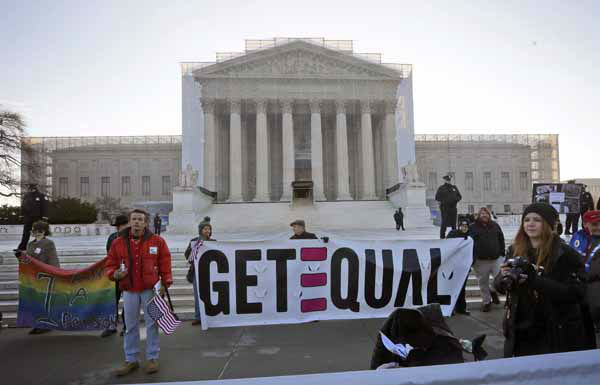 Demonstrators stand outside the Supreme Court in Washington, Tuesday, March 26, 2013, where the court will hear arguments on California?s voter approved ban on same-sex marriage, Proposition 8. &#40;AP Photo&#47;Pablo Martinez Monsivais&#41; <span class=meta>(AP Photo&#47; Pablo Martinez Monsivais)</span>