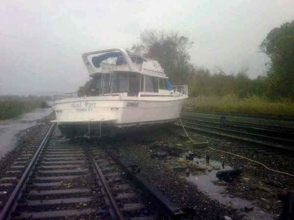 This photo provided by the Metropolitan Transportation Authority of the State of New York shows a boat resting on the tracks at Metro-North&#39;s Ossining Station in the aftermath of Hurricane Sandy on Tuesday, Oct. 30, 2012, in Ossining,N.Y. Sandy, the storm which was downgraded from a hurricane just before making landfall, caused multiple fatalities, halted mass transit and cut power to more than 6 million homes and businesses. &#40;AP Photo&#47;Metropolitan Transportation Authority of the State of New York&#41; MANDATORY CREDIT <span class=meta>(AP Photo&#47; Uncredited)</span>